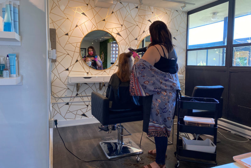 Salon crew with client in their house Home salon insurance| Sparrow Insurance